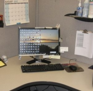 Take Back Your Desktop With A Monitor Cubicle Hanger
