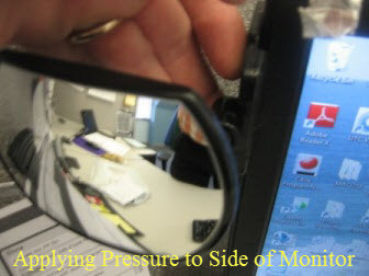 Applying Pressure to Computer Mirror