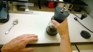 Unscrewing grinder top