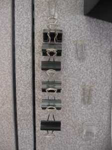 Hanging binder clips from a panel wall wire hook