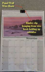 Hanging a calendar with a panel wall wire Hook and a binder clip
