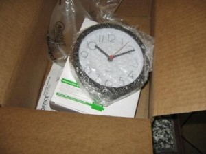Cubicle clock in wrapper and Amazon box.