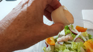 Pouring the dressing
