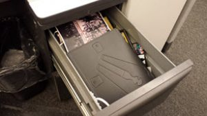 Cubicle drawer before decluttering
