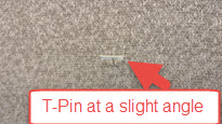 Just angle the T-Pin slightly into the wall.