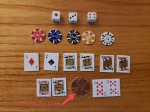 3 dice, 5 poker chips, and 10 playing cards