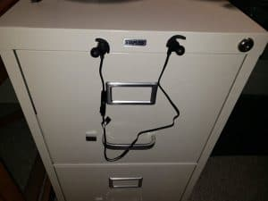 Magnetic headphones hanging from my metal file cabinet