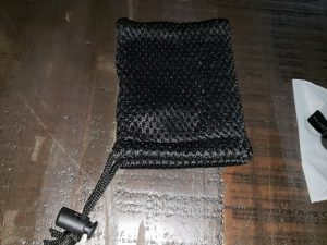 Fishnet pull-tie headphone pouch